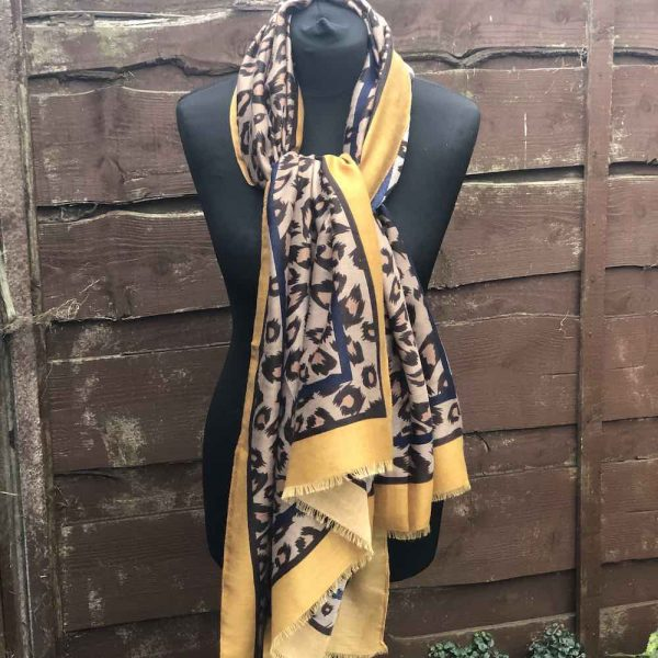 Animal print with mustard scarf