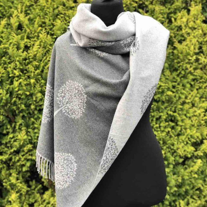 Grey Mulberry scarf worn as a blanket scarf