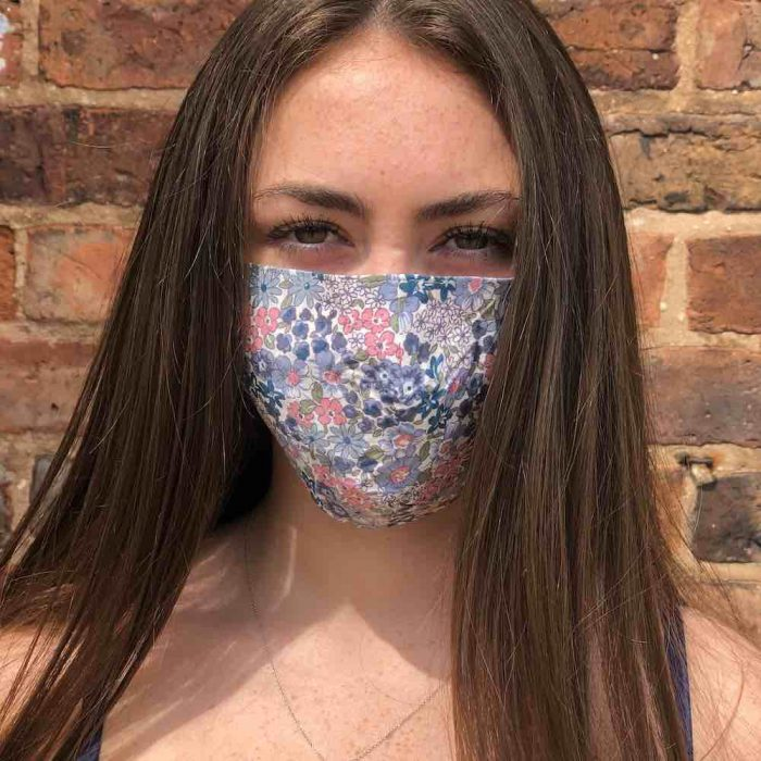 blue and pink face mask on pretty girl