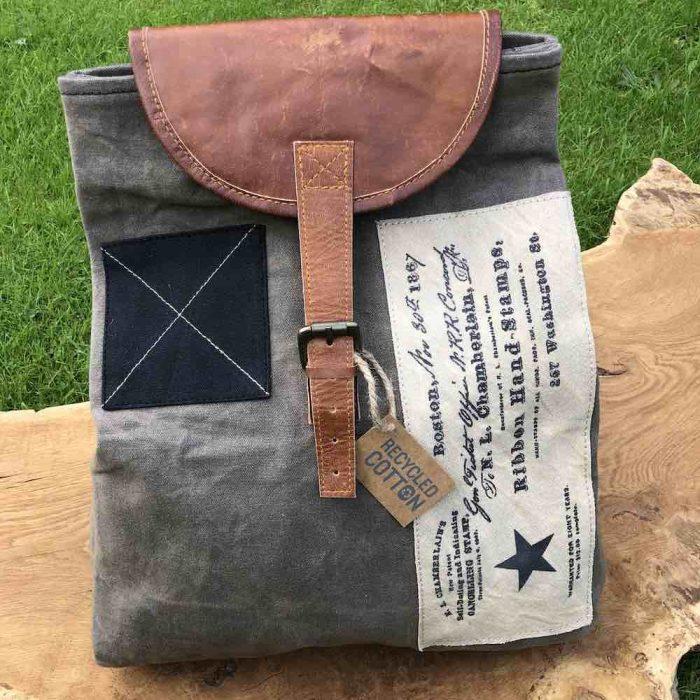 grey vintage canva backpack