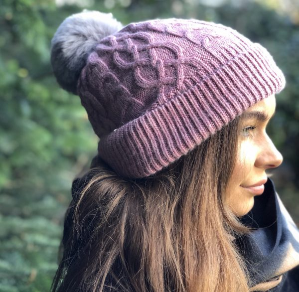 Pink aran knitted bobble hat with grey faux fur pompom