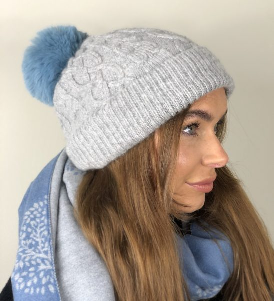 right side veiw of grey aran hat with pale blue pom pom