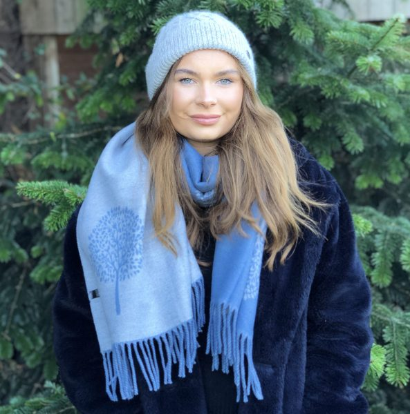 front veiw of girl wearing grey aran hat and mulberry scarf