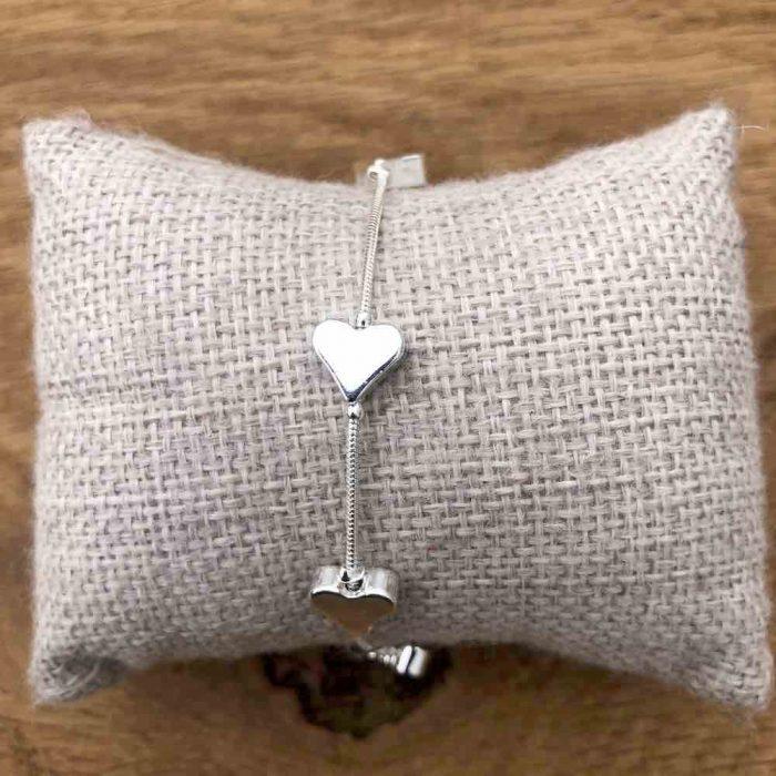 silver heart glide bracelet on cushion