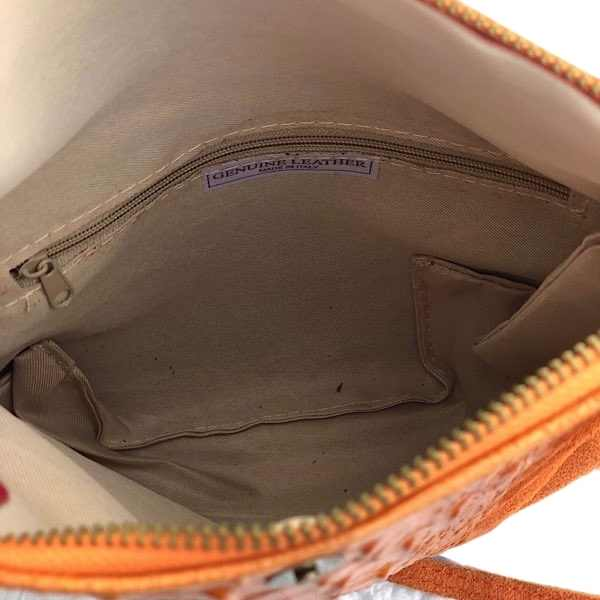 lining of orange clutch